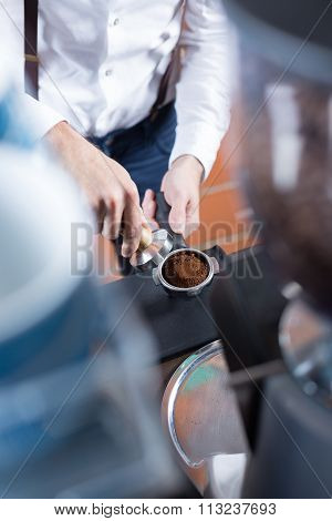 Close-up Of Man Hands With Holder Pressing Coffee