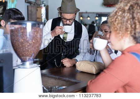 Four People Degustate Coffee