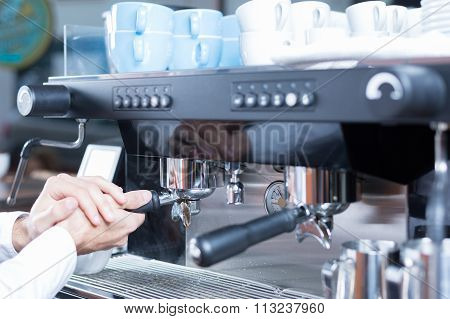 Man Hands Putting Holder In Coffee Machine