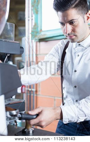 Portrait Of Handsome Bartender Grinding Coffee