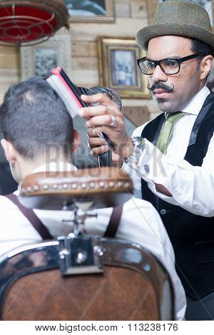 Portrait Of Stylish Barber Blow Drying Client Hair