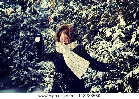 Teenage woman playing snowball fight