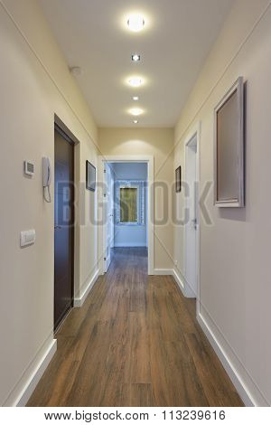 Apartment Corridor With Brown Floor
