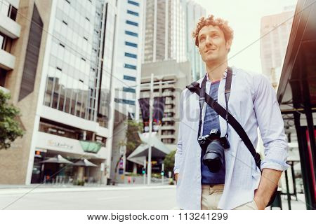 Happy male tourist in casual clothes in city walking