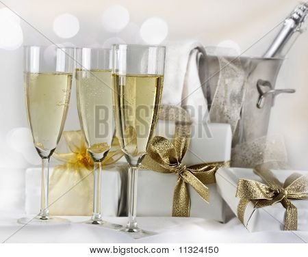 Glasses of champagne  and gifts