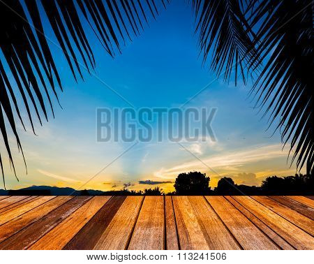 Silhouette Shot Image Of Coconut Tree And Sunset Sky In Background .