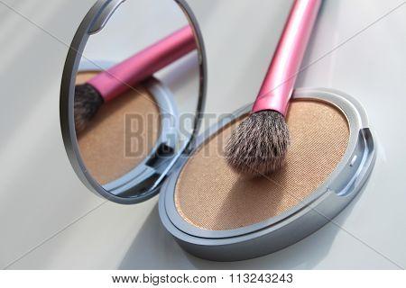face powder and makeup brush