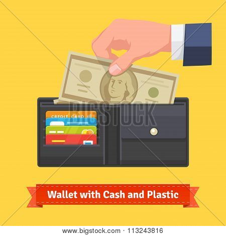 Leather wallet with some dollars and credit cards