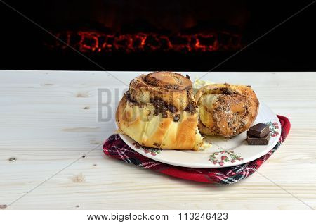 Cinnamon Rolls By The Fireplace
