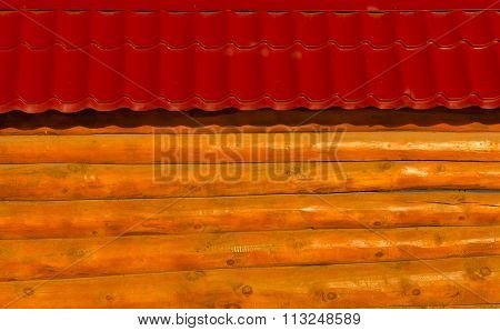 wooden fence made of solid timber with red roof background.