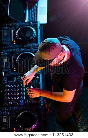 DJ man mixing electronic music