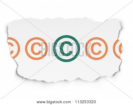 Law concept: copyright icon on Torn Paper background