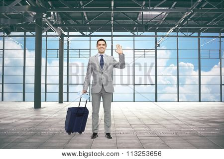 businessman with travel bag and ticket at airport