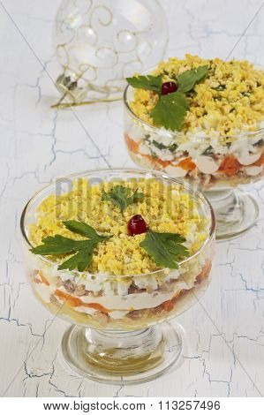 Salad Mimosa Served In Glass Bowls And Christmas Tree Ball