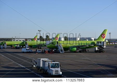 SOCHI, RUSSIA - OCTOBER 3, 2015: Airplanes of S7 airlines preparing for flight in Sochi airport. Novosibirsk based S7 Airlines has 58 airplanes and is a member of Oneworld Alliance