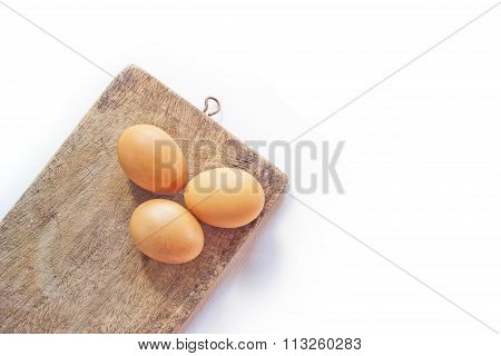 Eggs on a wooden cutting board