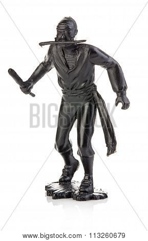 Angry Pirate With A Knife In His Hand Close-up Isolated On White . Miniature Figurine Of A Children'
