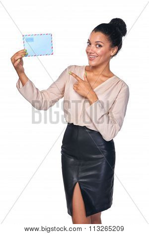 Smiling businesswoman with mail