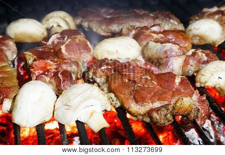 Pork Chops And Champignon Mushrooms Grilling On A Bbq