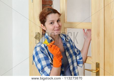 Young Girl Worker, Painting New Wooden Door