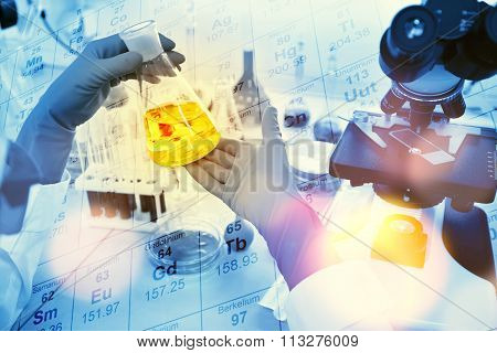 Close-up Of Clinician Working With Tools During Scientific Experiment In Laboratory With Chemical Ta