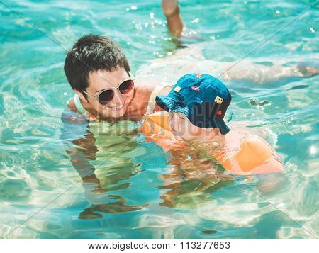 Baby and mother in a sea