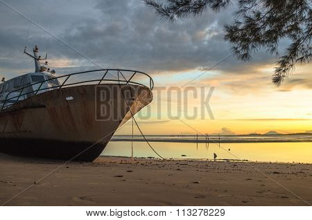 The Wrecked Ship with sunrise at  Kg Nagalang beach, Labuan, Malaysia.