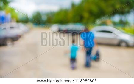 Image Of Blur People Walking At Car Park  On Day Time