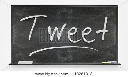 Tweet written on blackboard