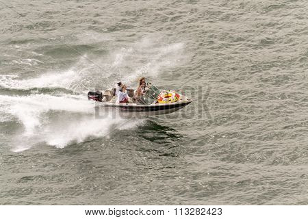 Montreal, Canada - June 07, 2015: Four People Driving A Speed Boat In Saint Laurent River In Montrea