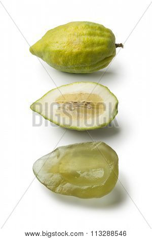 Fresh green whole and half Citrus medica and succade on white background