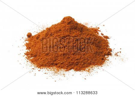 Heap of ground chili powder on white background