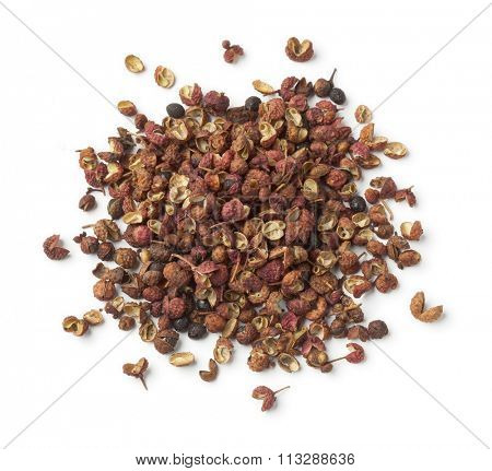 Heap of dried Sichuan pepper seeds on white background