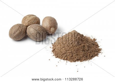 Heap of ground Nutmeg powder and seeds on white background