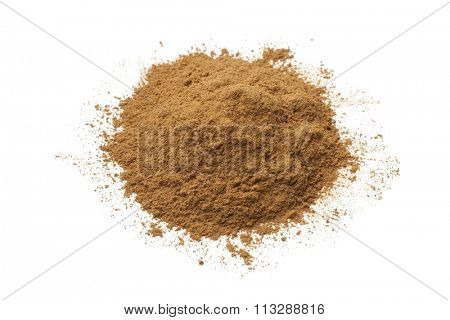 Heap of ground Cinnamon powder on white background