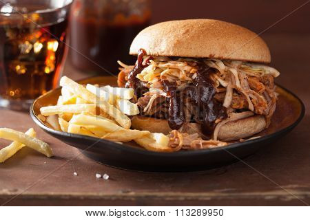 homemade pulled pork burger with coleslaw and bbq sauce