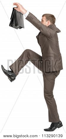 Businessman climbing up  with suitcase