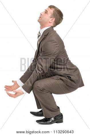 Businessman holding heavy empty space