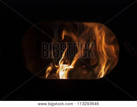 The Flame In The Viewing Window Of An Oven