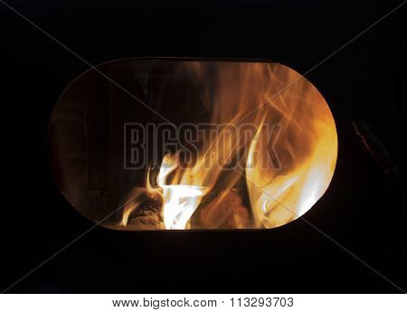 The Fire In The Hearth, In The Oval Window Of The Oven
