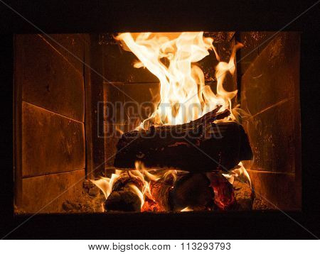 Warm Fireplace In The Winter Night