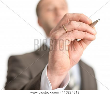 Businessman writing with pen on screen
