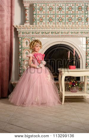 Girl  in a beautiful vinage dress fireplace