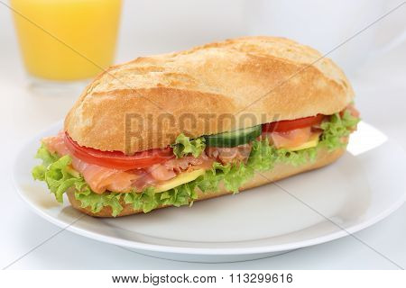 Sub Deli Sandwich Baguette For Breakfast With Salmon Fish And Orange Juice