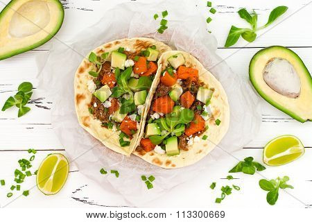 Mexican tacos with meat sweet potatoes and cotija cheese