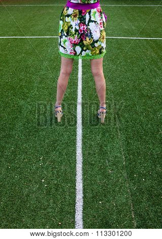 Woman Legs On The Soccer Field