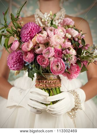 Stylized Bride Holding Beautiful Bouquet