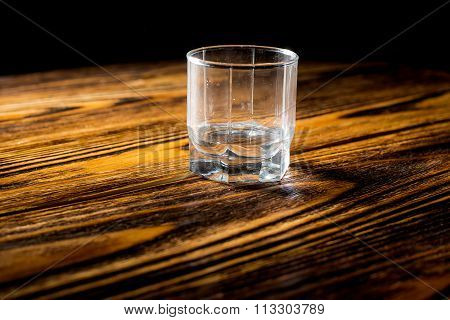 empty glass of vodka on the table