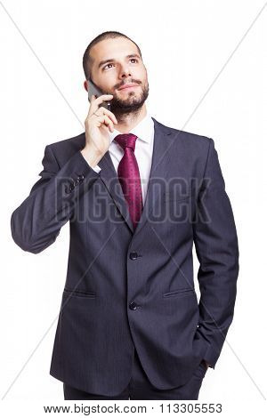 Handsome businessman talking on the phone, isolated on white background