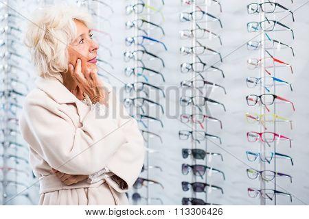 Senior Lady Chosing Eyeglass Frames